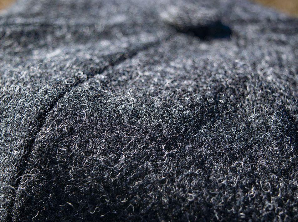 Newsboy tweed cap close-up