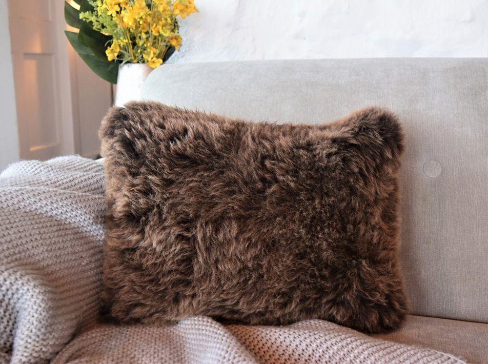 Oblong sheepskin cushion brown