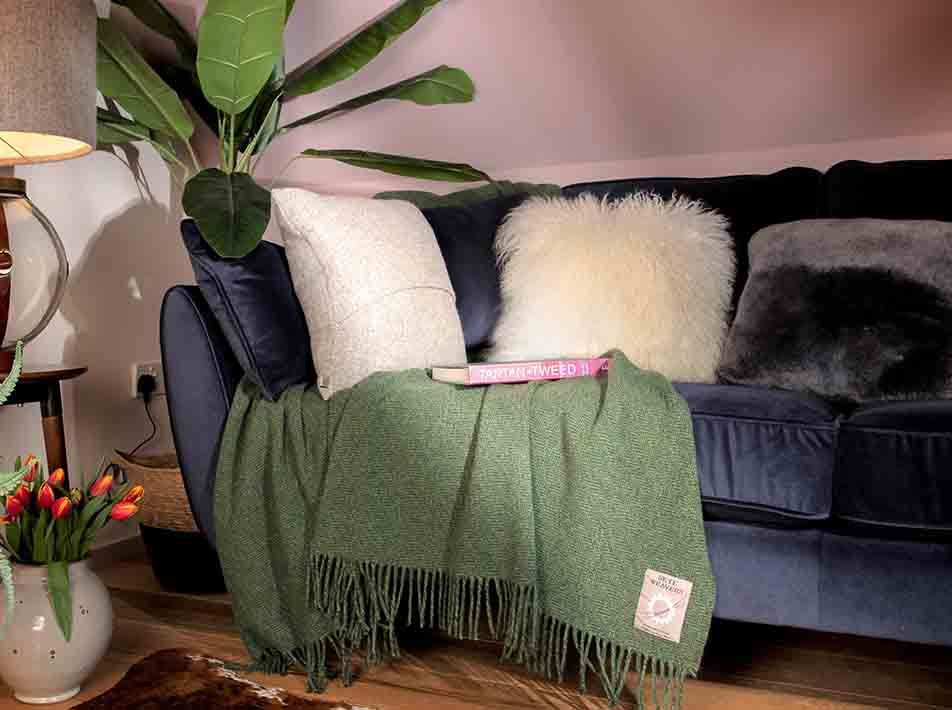 Yeti Sheepskin Cushion on sofa